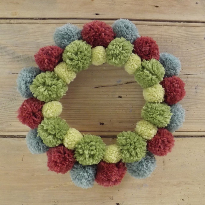 All of your left over wools can be used to make a mixed autumnal wreath. We have ours hung on our bedroom door.