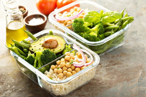 Fresh prepped vegetables in clear glass Tupperware containers for meal prep.