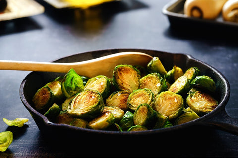 Small skillet of cooked brussels sprouts.