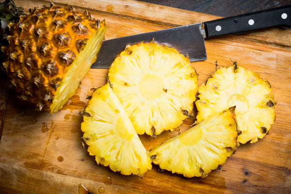 A Step-By-Step Guide to Cutting Up a Pineapple