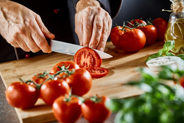A Step-By-Step Guide to Slicing a Vine-Ripened Tomato