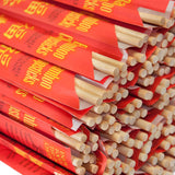 Close-up of Disposable Bamboo Chopsticks in Red Sleeves