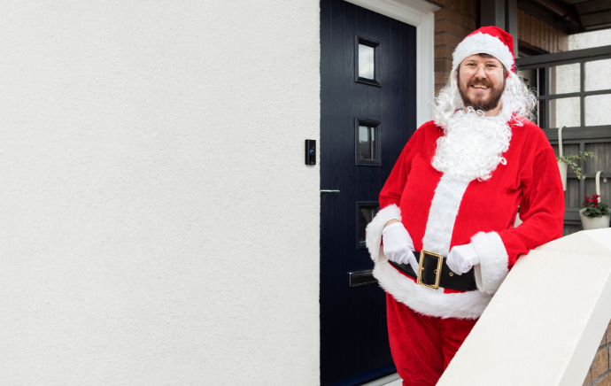 A red suit, white beard, and Ring Protect help make the festive season extra special for this young family.