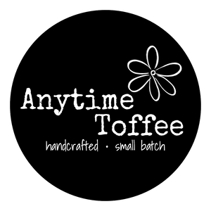 "Anytime Toffee logo ""handcrafted"" ""small batch"" black label with daisy"