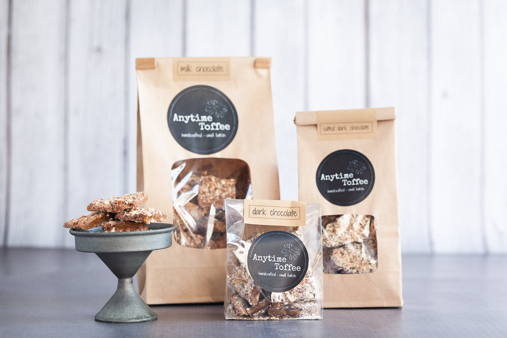 Bags of toffee in resealable kraft paper bags in 14, 7 and 3 oz sizes.  Also in 1.3 oz bars.