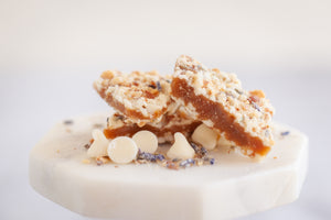 White chocolate lavender butter crunch toffee layered in white chocolate, toasted almonds and lavender.