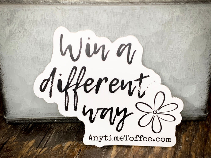 Win a different way sticker