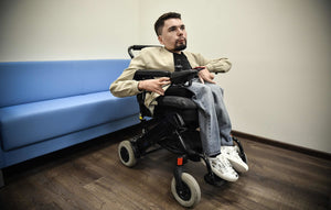 Putin's Toughest Online Critic Brings His Name and Wheelchair Into the Light