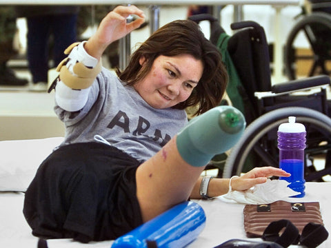 Tammy Duckworth in physical therapy