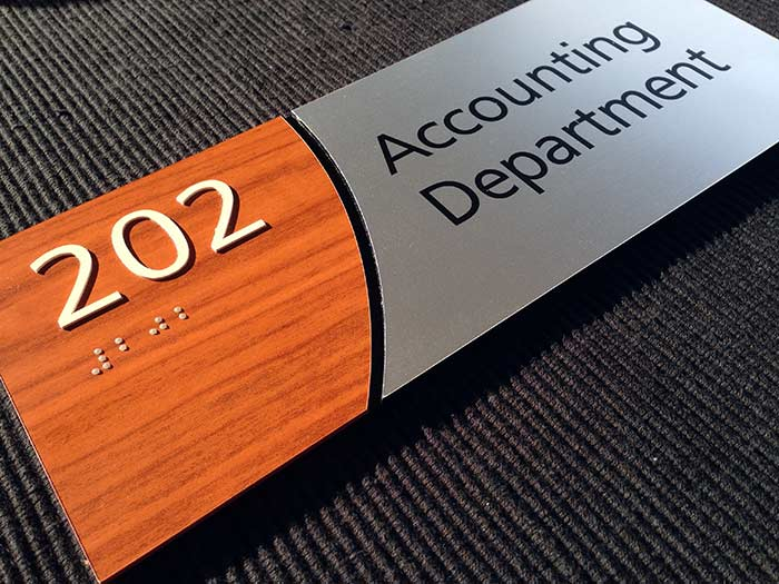 Wood laminate and brushed aluminum ADA Signs from ADA Sign Depot