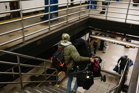 person-with-stroller-on-subway-stairs