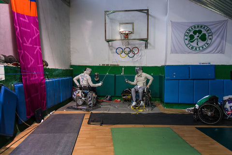 wheelchair fencing champions practicing