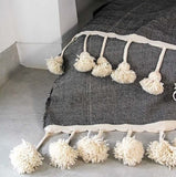 DELUXE LONG TASSEL, POM POM BLANKET, BLACK + CREAM WEAVE