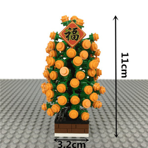 Kumquat tree with God of Wealth