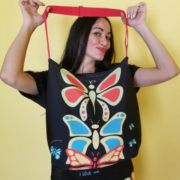 "Butterflylove Tote is the perfect size for carrying a change of clothes, your Butterfly Makeup Bag, and why not? Your favorite book! . Tote made from a soft, supple double knit neoprene fabric, 92% polyester, 8% spandex. Butterfly vibrant design. Easy adjustable 44"" strap. by RedButterfly by Omaris"