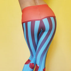 Super soft and comfortable capris, leggings.  Beautiful design with stripes, and tulips with blue and orange tones. 82% polyester/18% spandex . Material has a four-way stretch. Great for dancewear, workout, yoga pants. by RedButterfly by Omaris