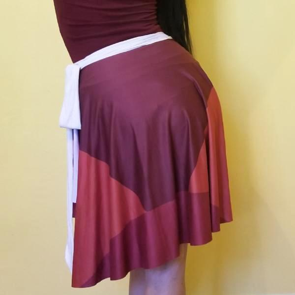 RedBlossom Wrap Skirt has Earthy and neutral colors. Perfect to match with all! The full circle printed wrap skirt is designed to fit all the beautiful curves. Very comfy and unique style.Brown colors with stripes. by RedButterfly by Omaris