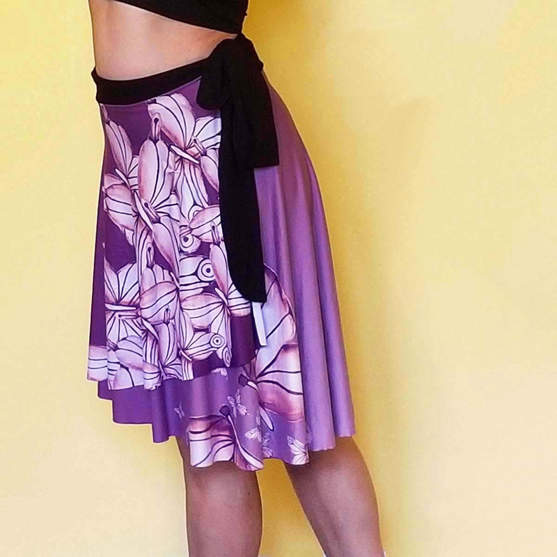 The Goddess Purple Wrap Skirt is designed to fit all the beautiful curves. Very comfy and unique style. Great for traveling.  - Medium weight soft jersey 92% polyester and 8% spandex - Available in one size - The waist tie is made from bamboo jersey fabric - Watercolor Butterflies  - Exclusive design by RedButterfly by Omaris