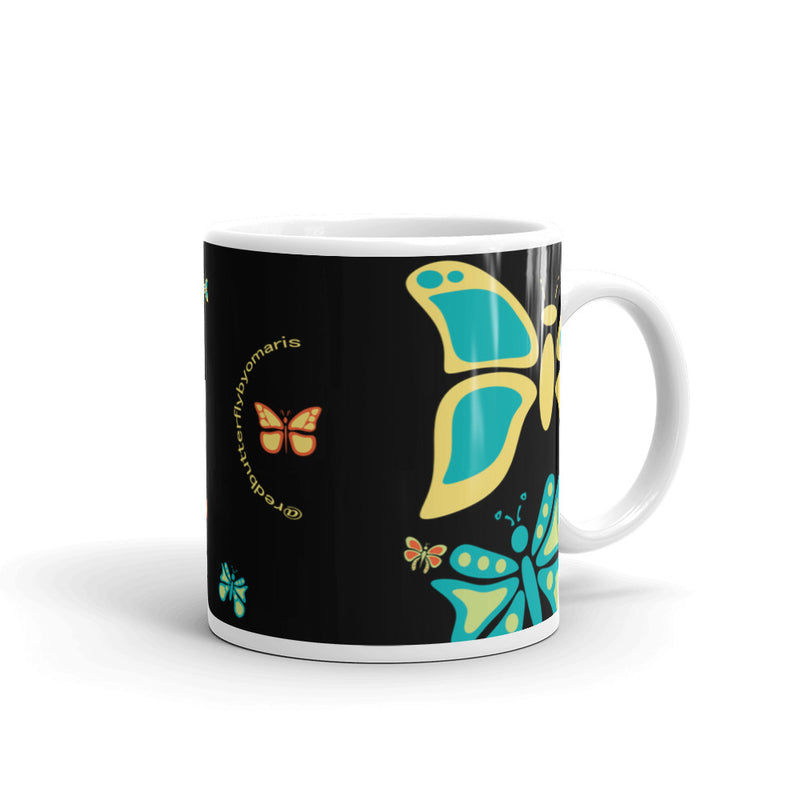 "Whether you're drinking your morning coffee, your evening tea, or something in between – this mug is for you! I prefer to drink ""Café con Leche"" with my Butterfly Charisma Mug every morning. - Ceramic - Dishwasher and microwave safe - White and glossy by RedButterfly by Omaris"