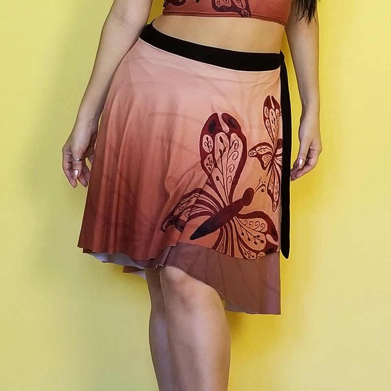 Neutral colors so you can match this beautiful wrap skirt with many other colors.  Very comfortable and with a fashionable style. - Medium weight soft jersey 92% polyester and 8% spandex - One Size - The waist tie is made with bamboo jersey fabric - Watercolor print - Exclusive design by RedButterfly by Omaris