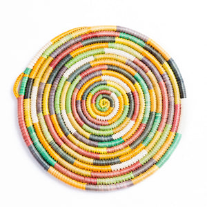Yemisirach Basket features our rainbow-like design. It's a hand-woven flat basket made by artisans in Ethiopia.