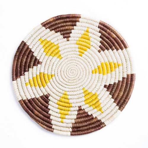 Buna Basket, a hand-woven flat basket made by artisans in Ethiopia