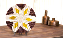 A lifestyle photo of Buna Basket displayed on a side table, mixed and matched with other accessories