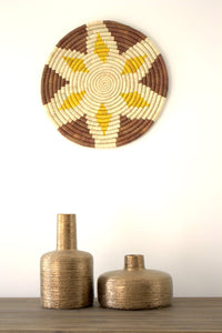 A lifestyle photo of Buna Basket mounted on the wall and complemented by other accessories