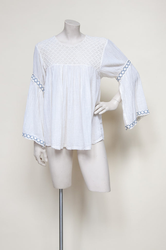 Vintage 1970s bell sleeved blouse from Velvetyogurt