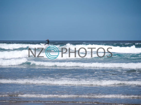 Piha Beach Surfer Stock Photo