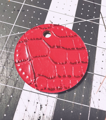 Vegetable tanned embossed leather in red color for back of Africa Hand Stitched Keychain.