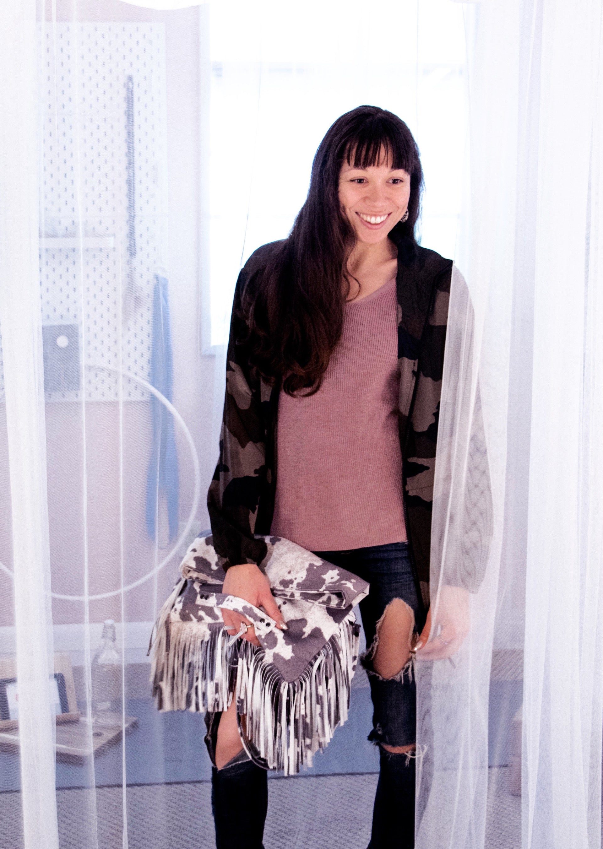 Oversized Fringe Clutch in Cow Print