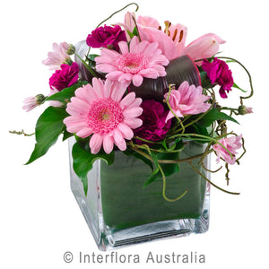 Precious Wandin Florist Wedding Flowers Arrangement in a vase Pink Gerberas Carnations Lily Dodda Vine Seasonal Foliage Glass Cube Yarra Valley lilydale