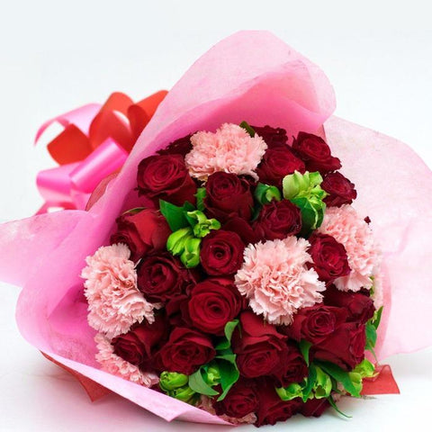 A beautiful bouquet of red roses and pink carnations