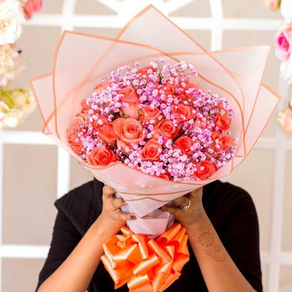 Orange Roses and Pink Baby's Breath Bouquet