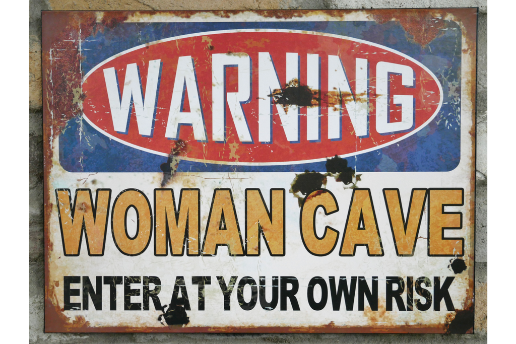 Woman Cave Warning Sign