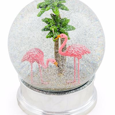 snow globe flamingo