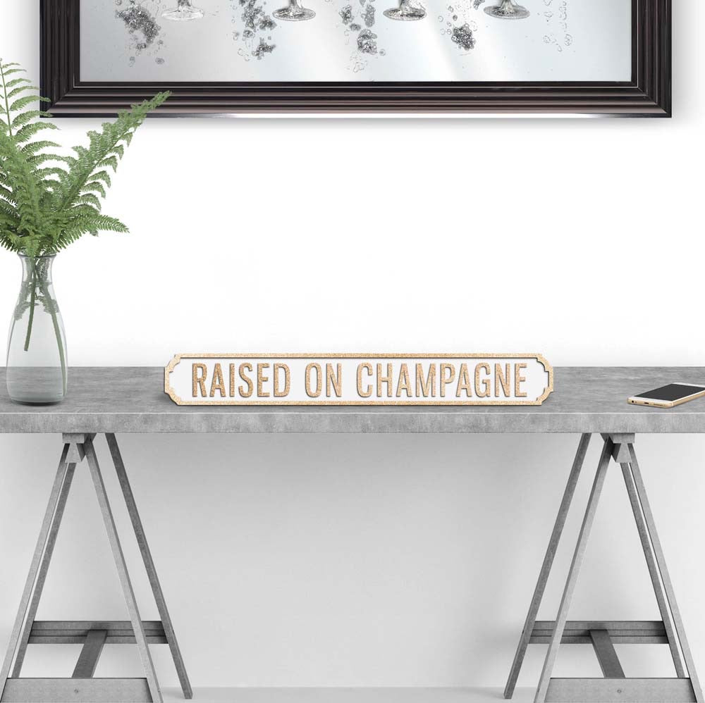 Raised on Champagne Wooden street road sign
