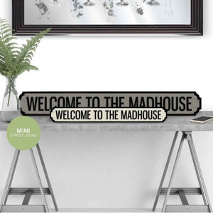 welcome to the madhouse street sign