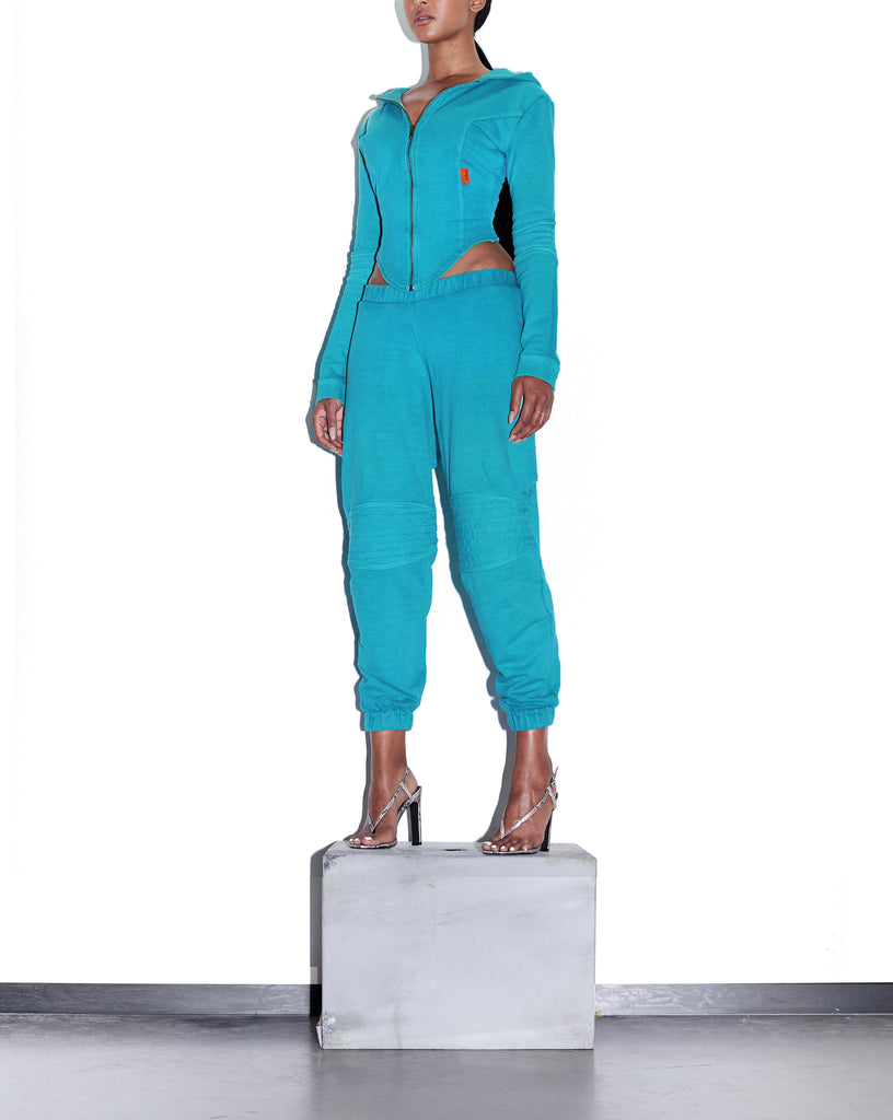 Model wears SIZE X-SMALL TONIK Slouch Panelled Joggers in Azure Blue by TheKLabel