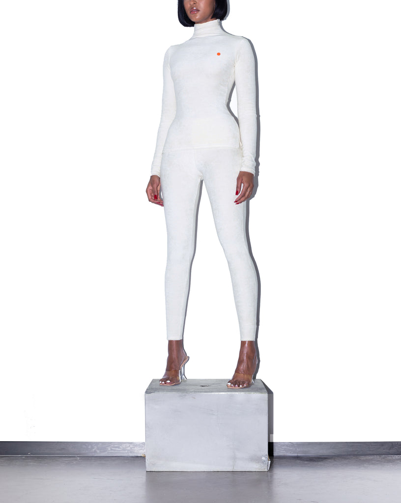Model wears XS KOOTCH Towelling Base Layer Top in Buttermilk by TheKLabel (overview)