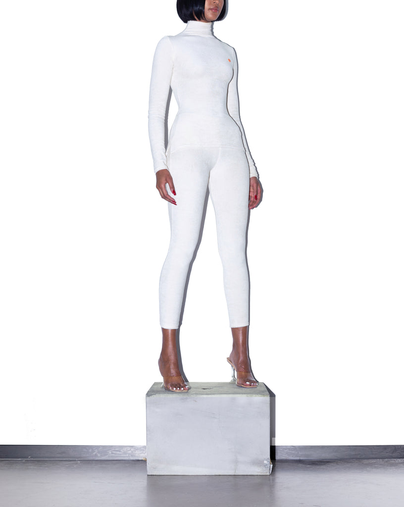 Model wears XS KOOTCH Towelling Base Layer Leggings in Buttermilk by TheKLabel (side)