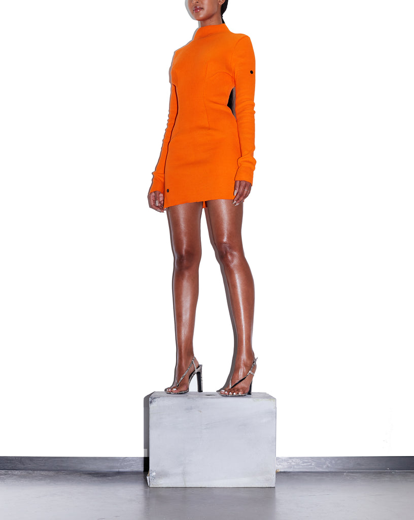 Model wears XS MAGMA Dart Zip-Down Mini Dress in Vivid Orange by TheKLabel