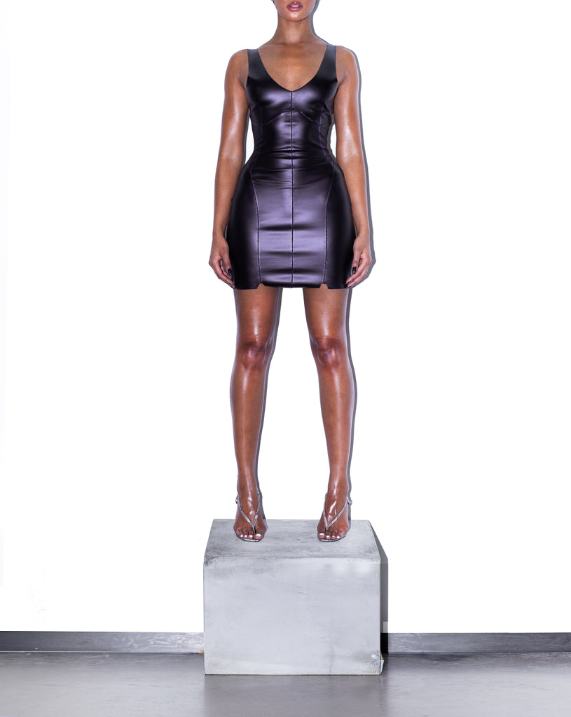 Model wears SIZE SMALL SLIQUE PU Contour Mini in Aubergine by TheKLabel