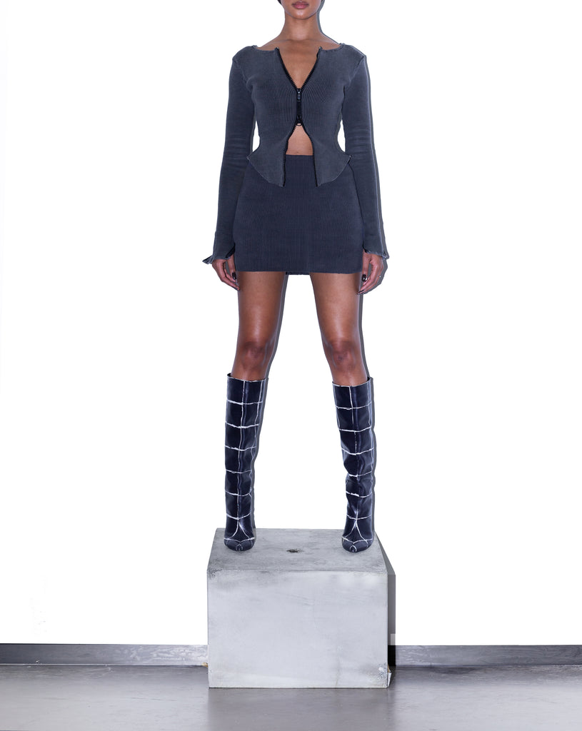 Model wears SIZE SMALL KACHE Raw Edge Rib Mini Skirt in Acid Black by TheKLabel (overview)