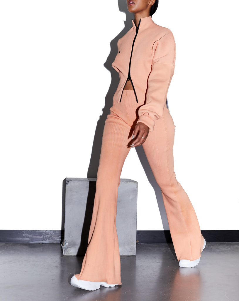 Model wears SMALL MELLOW Raw Edge Rib Flares in Peach Apricot by TheKLabel