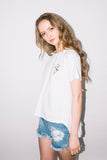 See You Never Clothing white daisy embroidery t-shirt