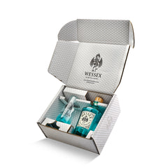 Cardboard plastic-free packaging for Alfred the Great gin and a Wessex Glass