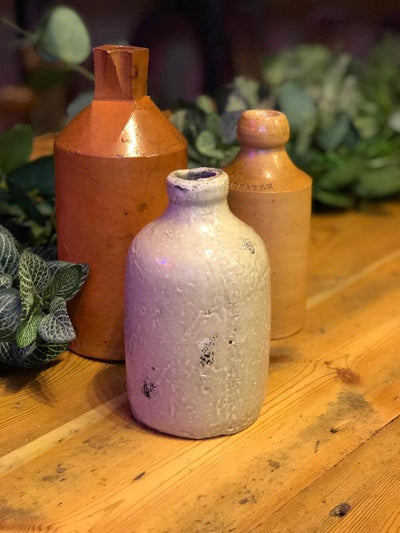 Stoneware bottles for hire by Rock the Day in Essex