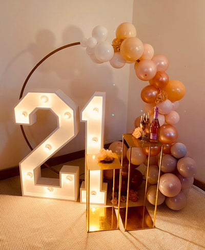 Birthday package hire with balloon garland and light up numbers | Party hire and event styling by Rock the Day Essex